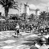 Photograph of pipers from the 51st Highland Division participating in the Allied victory parade through Tunis, May 1943 (Crown Copyright, National Records of Scotland, NSC1/394/52)