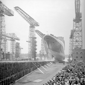 Photograph of the Cunard liner RMS Queen Elizabeth 2 going down the slipway at the shipyard of John Brown & Company, Clydebank, 20 Sep 1967 (Crown Copyright, National Records of Scotland,UCS1/118/736/1356)