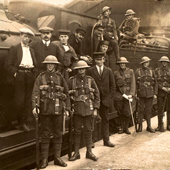 Image of soldiers, a sailor and railway staff at Galashiels Station, about 1916 (Image Gallery Reference: AAA00407)