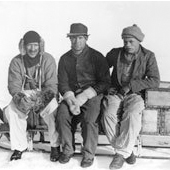 Photograph of Martin Lindsay, J M Scott and A Stephenson on a sledge during the British Arctic Air-Route Expedition of 1930-1931 (Crown Copyright, National Records of Scotland, GD254/1260/8)