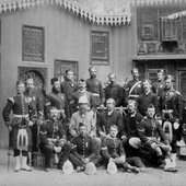 Photograph of officers and men of [The Black Watch, (Royal Highlanders)] standing in front of Egyptian vernacular building at the time of the Anglo-Egyptian War, 1882 (Crown Copyright, National Records of Scotland, GD483/26/1)
