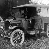 Photograph of a YMCA driver of the British 3rd Army, with his van in France, 1918 (Crown Copyright, National Records of Scotland, GD476/6/1/73)