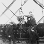 Photograph of a group of four riveters at work with a pneumatic riveting machine on the Forth Railway Bridge, 1887 (Crown Copyright, National Records of Scotland, BR/FOR/4/34/2)