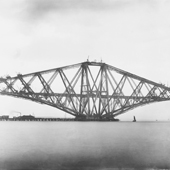 Photograph showing a broadside view the Queensferry cantilever of the Forth Railway Bridge in an advanced stage of construction, May 1889 (Crown Copyright, National Records of Scotland, BR/FOR/4/34/5)