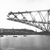Photograph of the Fife S Cantilever of the Forth Railway Bridge under construction reaching over the Forth to the north shore covered on steam cranes and hoists, 24 May 1889 (Crown Copyright, National Records of Scotland, BR/FOR/4/34/49)