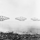 Photograph of the view from the east of the three piers of the Forth Railway Bridge, cantilevers completed but central connecting girders not yet commenced, 15 April 1889 (Crown Copyright, National Records of Scotland, BR/FOR/4/34/189)