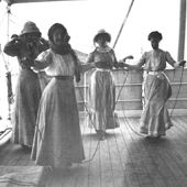 Photograph of young passengers skipping on deck of a cruise ship, 1910 (Crown Copyright, National Records of Scotland,GD1/585/24)