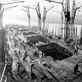 Photograph of the View looking down towards the bow of the deck showing guide rails for the turrets being fitted on the Royal Navy battlecruiser HMS Tiger under construction at John Brown & Co. shipyard, Clydebank, 5 December 1913 (Crown Copyright, National Records of Scotland,UCS1/116/10/49)