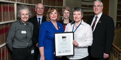 Photograph of Fiona Hyslop presenting the Archives Accreditation Award to NRS staff