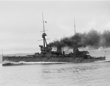 Detail from photograph of HMS Inflexible at speed during trials, autumn 1908. She was capable of 26.64 knots (UCS1/118/374/46).