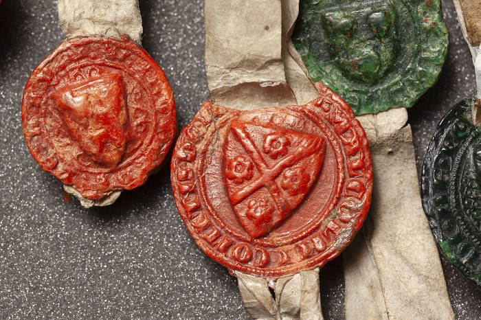 Image of a detail of the Declaration of Arbroath. Close up of seals.
