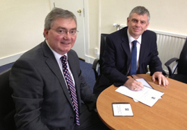 Bruno Longmore, left, Head of NRS Government Records Branch receiving the RMP of Scottish Legal Aid Board from Graeme Hill, right, Director of Corporate Services and Accounts